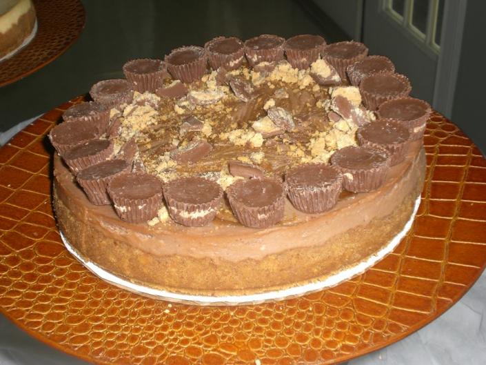 [Image: single tier white grooms cake topped with his favorite peanut butter cup]