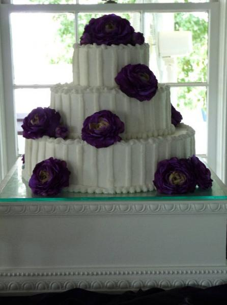 [Image: Purple and white cake at Childrens Harbor]