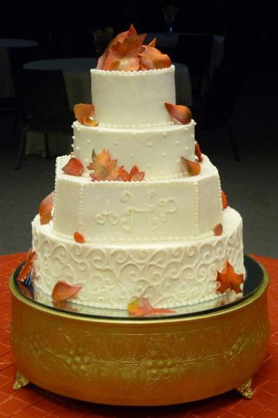 [Image: Brides cake with edible Fall leaves]